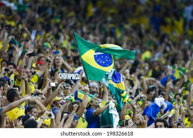 SAO PAULO, BRAZIL - June 12, 2014: Fans supporting the Brazil team during the World Cup Group A opening game between Brazil and Croatia at Corinthians Arena. No Use in Brazil.