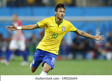 SAO PAULO, BRAZIL - June 12, 2014:Neymar of Brazil celebrates during the World Cup Group A opening game between Brazil and Croatia at Corinthians Arena. No Use in Brazil.