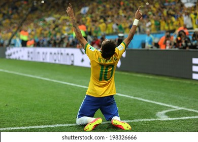 SAO PAULO, BRAZIL - June 12, 2014: Neymar (r) of Brazil celebrates during the World Cup Group A opening game between Brazil and Croatia at Corinthians Arena. No Use in Brazil.