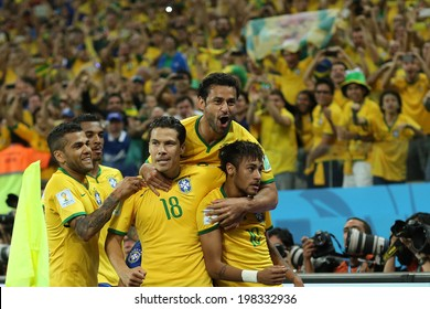 SAO PAULO, BRAZIL - June 12, 2014: Neymar (r) and Brazilian players celebrate during the World Cup Group A opening game between Brazil and Croatia at Corinthians Arena. No Use in Brazil.
