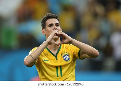 SAO PAULO, BRAZIL - June 12, 2014: Oscar of Brazil celebrates a goal during the World Cup Group A opening game between Brazil and Croatia at Corinthians Arena. No Use in Brazil.
