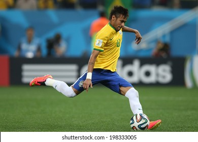 SAO PAULO, BRAZIL - June 12, 2014 : Neymar of Brazil takes a penalty during the World Cup Group A opening game between Brazil and Croatia at Corinthians Arena. No Use in Brazil.
