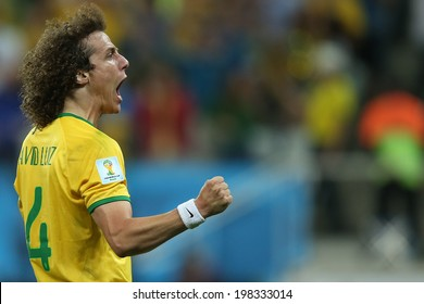 SAO PAULO, BRAZIL - June 12, 2014: Luiz of Brazil celebrates a goal during the World Cup Group A opening game between Brazil and Croatia at Corinthians Arena. No Use in Brazil.