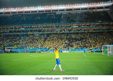 SAO PAULO, BRAZIL - June 12, 2014: Neymar of Brazil celebrates after scoring a goal during the World Cup Group A opening game between Brazil and Croatia at Corinthians Arena. No Use in Brazil.