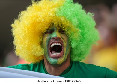 SAO PAULO, BRAZIL - June 12, 2014: Soccer fans during the World Cup Group A opening game between Brazil and Croatia at Corinthians Arena. No Use in Brazil.