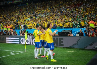 SAO PAULO, BRAZIL - June 12, 2014: Brazil team celebrates after Neymar's goal during the World Cup Group A opening game between Brazil and Croatia at Corinthians Arena. No Use in Brazil.