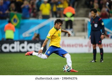 SAO PAULO, BRAZIL - June 12, 2014: Neymar kicks the ball during the World Cup Group A opening game between Brazil and Croatia at Corinthians Arena. No Use in Brazil.