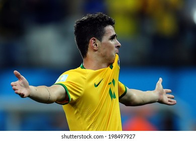 SAO PAULO, BRAZIL - June 12, 2014: Oscar of Brazil celebrates after scoring a goal during the World Cup Group A opening game between Brazil and Croatia at Corinthians Arena. No Use in Brazil.