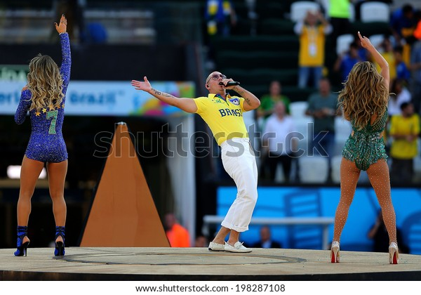 SAO PAULO, BRAZIL - June 12, 2014: Singer Claudia Leitte, Rapper Pitbull, and singer Jennifer Lopez performing at the opening ceremony of FIFA 2014 World Cup at Corinthians Arena. No Use in Brazil.