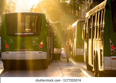 Sao Paulo, Brazil, June 17, 2014. Bus and pedestrian movement, on a late afternoon, on Sao Joao Avenue and Paissandu Square, in Downtown of Sao Paulo