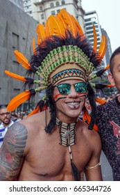 SAO PAULO, BRAZIL - June 18, 2017: An unidentified young man dressed in a costume celebrating lesbian, gay, bisexual, and transgender culture in the 21st Gay Pride Parade Sao Paulo.
