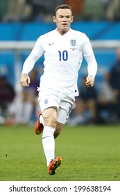 SAO PAULO, BRAZIL - June 19, 2014: Wayne Rooney of England kicks the ball during the 2014 World Cup Group D game between Uruguay and England at Arena Corinthians. No Use in Brazil.
