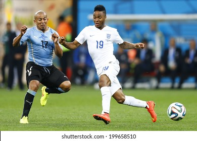 SAO PAULO, BRAZIL - June 19, 2014: Egidio Arevalo Rios of Uruguay and Raheem Sterling of England compete for the ball during the game between Uruguay and England at Arena Corinthians. No Use in Brazil