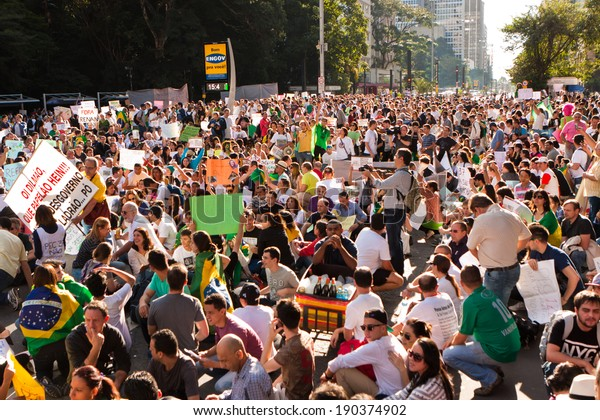 Sao Paulo, Brazil - June 22. Some protesters marching on Paulista Avenue  holding signs with messages against the brazilian goverment on June 22nd, 2013 in Sao Paulo, Brazil.