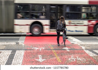 Sao Paulo, Brazil, June 29, 2016. Cyclist awaits the traffic light to cross the road, stop at the cycle path of Joao Mendes square, historic center of Sao Paulo
