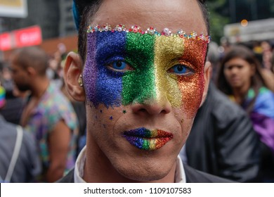 Sao Paulo, Brazil - June 3, 2018: An unidentified man with face painted celebrating the lesbian, gay, bisexual, and transgender culture in the 22th LGBTI Pride Parade Sao Paulo.
