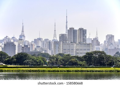 Sao Paulo (Brazil) Lake and park in foreground, skyscrapers with antennas in background