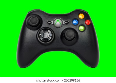 SAO PAULO, BRAZIL - MAR 13, 2014: The wireless gamepad for the Xbox 360, a home video game console produced by Microsoft, isolated on light green background.