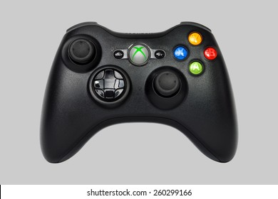 SAO PAULO, BRAZIL - MAR 13, 2014: The wireless gamepad for the Xbox 360, a home video game console produced by Microsoft, isolated on grey 25% background.