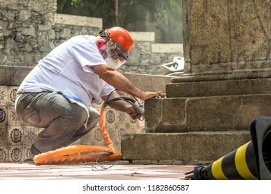 Sao Paulo, Brazil, March 10, 2014. Work to clean vandalism graffiti, waterproof and restore the Obelisco da Memoria, the oldest monument in Sao Paulo. Image Graffiti is vandalism and has no author