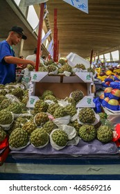 Sao Paulo, Brazil - March 20 2016: An unidentified man at commerce, selling vegetables, fruits and food at famous place called Ceagesp, Sao Paulo City