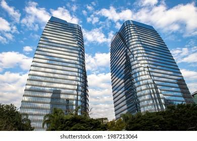 Sao Paulo, Brazil - May 26, 2021 - The glass facade of a modern architecture corporate office building located at Brigadeiro Faria Lima avenue on Vila Olimpia neighborhood.
