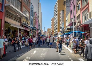 Sao Paulo, Brazil - Nov 13, 2017: 25 de Marco Street, popular shopping street in downtown Sao Paulo - Sao Paulo, Brazil