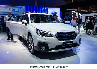 SAO PAULO, BRAZIL - NOV 15, 2018: Front of a Subaru Outback AWD (Japanese 5-door midsize station wagon/crossover SUV - 6th generation) inside Subaru pavilion at 2018 Sao Paulo International Motor Show