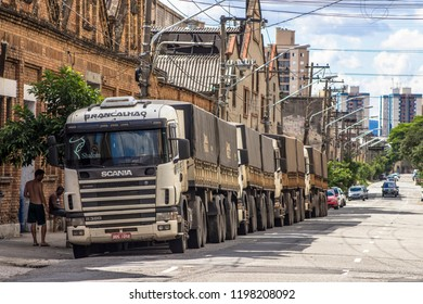 Sao Paulo, Brazil, November 11, 2012. Trucks parked in front of old warehouses, in the Mooca neighborhood, along the railway line where it was the former industrial zone of Sao Paulo.