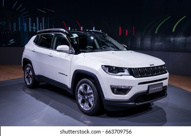 SAO PAULO, BRAZIL - NOVEMBER 14, 2016: A white Jeep Compass displayed on a turntable inside Jeep pavilion at 2016 Sao Paulo International Motor Show.