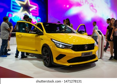 SAO PAULO, BRAZIL - NOVEMBER 15, 2018: A yellow Fiat Argo HGT (sport version hot hatch) subcompact 5-door hatchback car displayed inside Fiat pavilion at 2018 Sao Paulo International Motor Show.