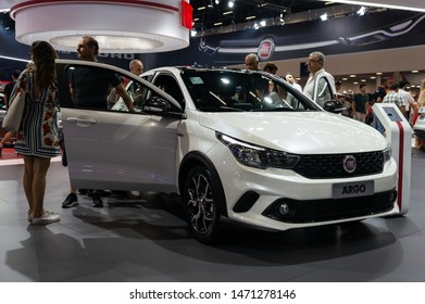 SAO PAULO, BRAZIL - NOVEMBER 15, 2018: A white Fiat Argo HGT (sport version hot hatch) subcompact 5-door hatchback car displayed inside Fiat pavilion at 2018 Sao Paulo International Motor Show.