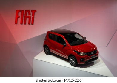 SAO PAULO, BRAZIL - NOVEMBER 15, 2018: A red Fiat Mobi Drive hatchback city car displayed on a platform outside Fiat pavilion at 2018 Sao Paulo International Motor Show.