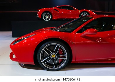 SAO PAULO, BRAZIL - NOVEMBER 15, 2018: Close up side view of a red Ferrari 488 GTB italian mid-engine sports car displayed inside the small Ferrari booth at 2018 Sao Paulo International Motor Show.