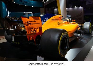 SAO PAULO, BRAZIL - NOVEMBER 15, 2018: Rear view of the orange McLaren MCL33 Formula 1 racing car displayed inside Petrobras pavilion at 2018 Sao Paulo International Motor Show.