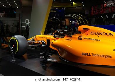 SAO PAULO, BRAZIL - NOVEMBER 15, 2018: Side view of the orange McLaren MCL33 Formula 1 racing car displayed inside Petrobras pavilion at 2018 Sao Paulo International Motor Show.