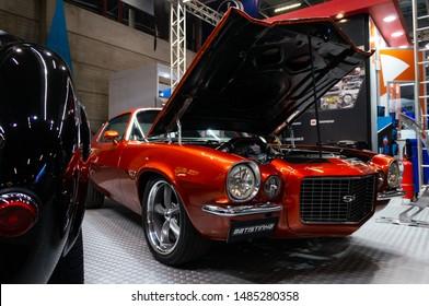 SAO PAULO, BRAZIL - NOVEMBER 15, 2018: A metallic orange 1971 Chevrolet Camaro RS/SS customized by Batistinha Garage displayed inside Batistinha booth at 2018 Sao Paulo International Motor Show.
