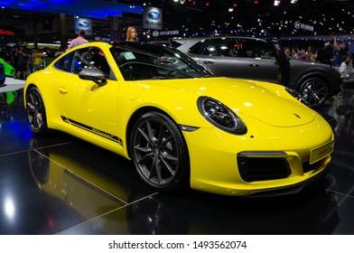 SAO PAULO, BRAZIL - NOVEMBER 15, 2018: An yellow Porsche 911 Carrera T (German two-door high performance rear-engined sports car) displayed Porsche pavilion at 2018 Sao Paulo International Motor Show.