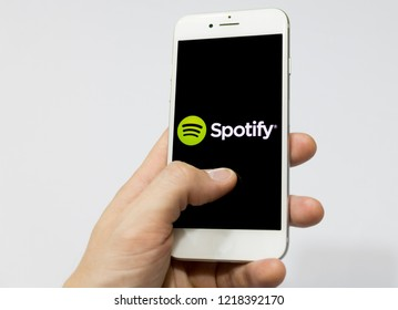 Sao Paulo, Brazil - November 2018: Male hand holding cell phone with Spotify logo. Smartphone App.