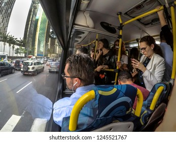 Sao Paulo, Brazil, November 26, 2018. Passengers inside of the bus with traffic jam in Paulista Avenue, in cetral region of Sao Paulo
