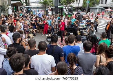 Sao Paulo, Brazil - November, 26 2017.  Sunday at Paulista Avenue (Avenida Paulista), business and financial street downtown. Crowd is watching musical group perfomance.