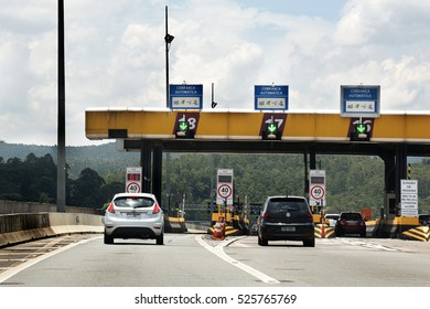 Sao Paulo, Brazil - November, 26th 2016: Highway toll plaza and speed limit, view of automatic paying lanes called in Portuguese Sem Parar, which means non-stop.