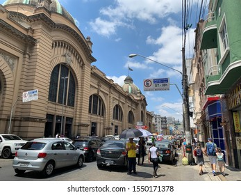 """Sao Paulo, Brazil, November 9, 2019: Sao Paulo Municipal Market Facade, """"Mercadão"""", an important historical and architectural building, houses booths specialized in wholesale and retail trade."""