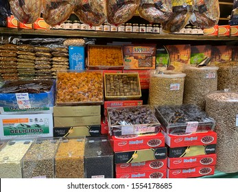 """Sao Paulo, Brazil, November 9, 2019: Sao Paulo Municipal Market, """"Mercadão"""", an important historical and architectural building, houses dried fruit and chestnut stands in wholesale and retail trade."""