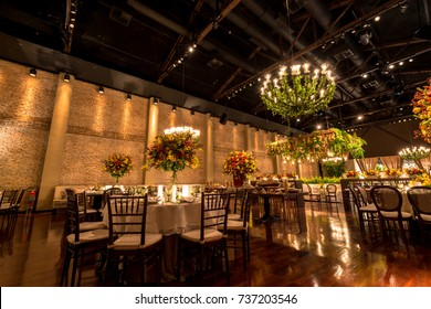 SAO PAULO, BRAZIL - OCTOBER 07, 2017: Long exposition picture of decorated party room with many tables for dinner and flowers decoration for a wedding party in the city of Sao Paulo, Brazil.