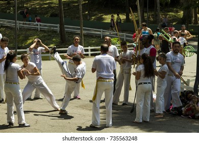 SAO PAULO, BRAZIL - OCTOBER 12, 2017: Brazilian capoeira group performing at an outdoor event in the Sao Paulo Horto Florestal Park in the child´s day. Young people presents their skills in the circle