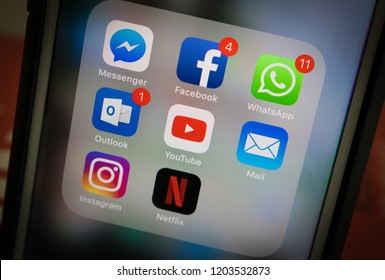 Sao Paulo, Brazil - October 2018 - Photo of a smartphone screen with Whatsapp, Facebook, Outlook, Youtube, Messenger, Mail, Instagram and Netflix icons.