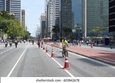 Sao Paulo, Brazil - October 23, 2016: Sunday or holiday in Paulista Avenue, where avenue is closed to motor vehicles and open for the public for fun, to walk, run, bike and skate through open avenue.