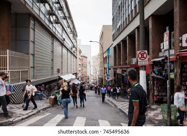 SAO PAULO, BRAZIL - OCTOBER 27th, 2017: Hundreds of people walk around the Street called 25 March in Sao Paulo, Brazil. This is a popular commerce region at downtown.