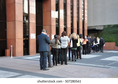 Sao Paulo, Brazil - October 5: People standing in a line to enter office building on Avenida Paulista in the morning on October 5, 2014 in Sao Paulo, Brazil.